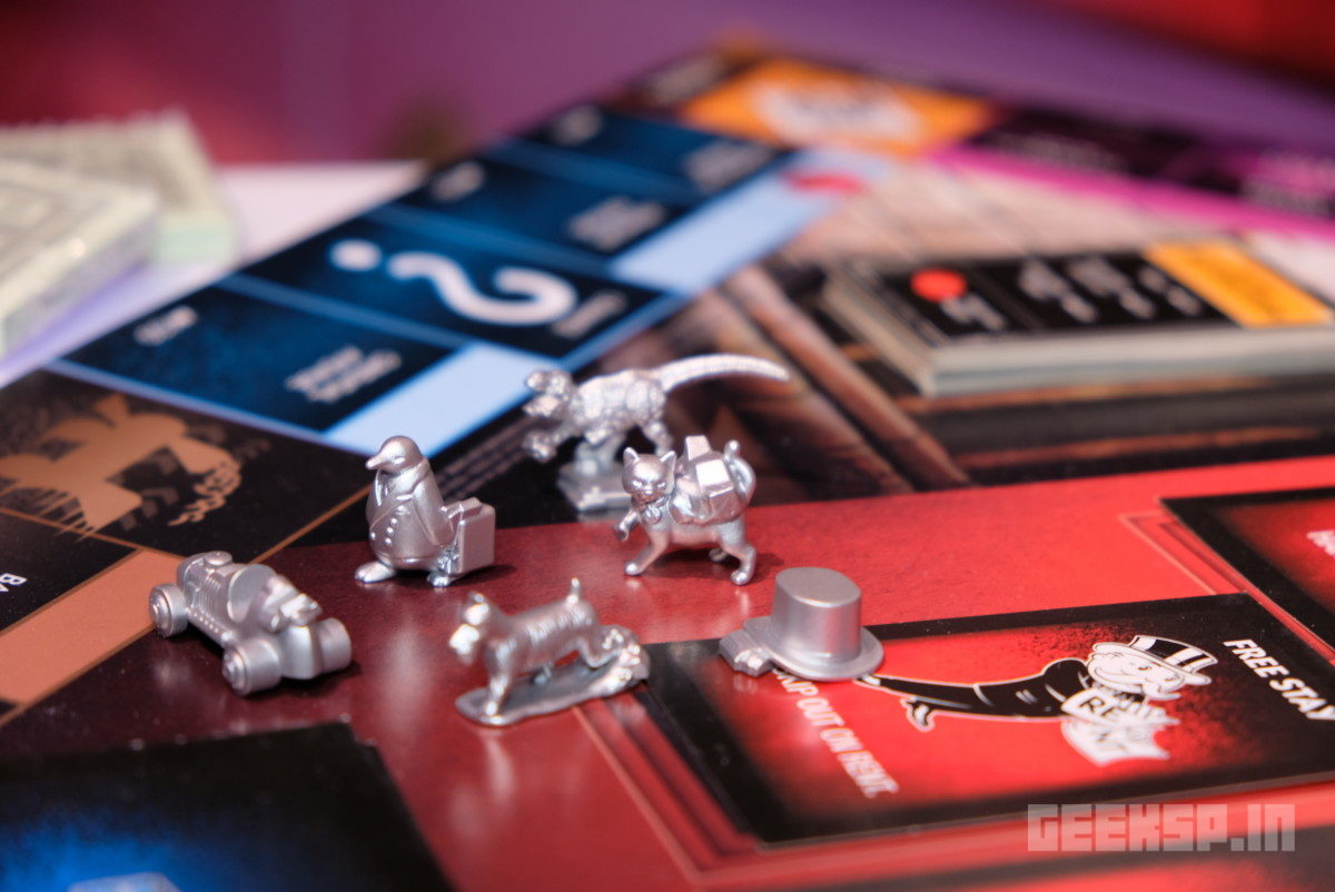 Monopoly Cheaters Edition comes with handcuffs 12