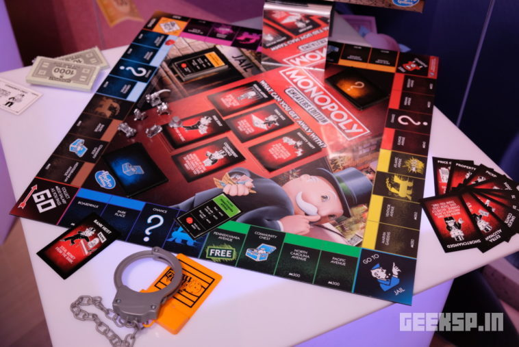 Monopoly Cheaters Edition comes with handcuffs 11