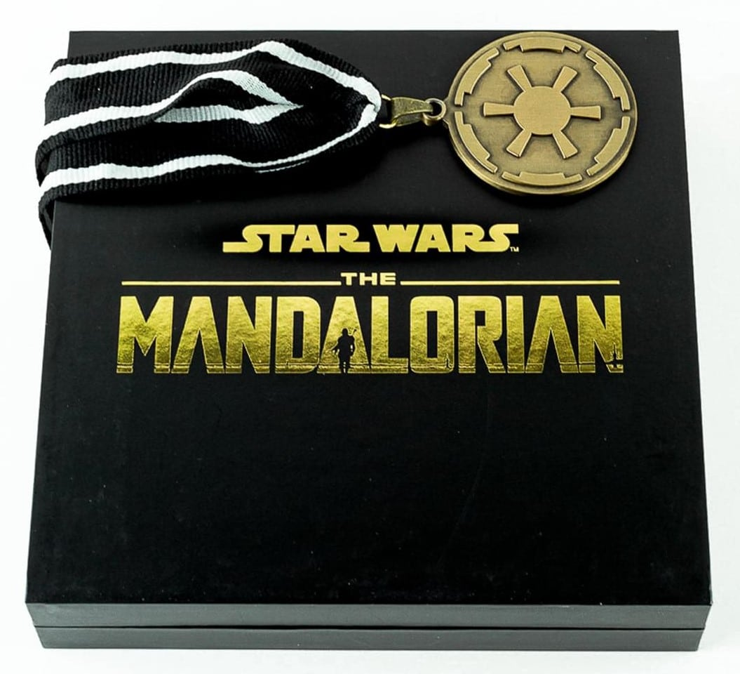 The Mandalorian cog necklace and Baby Yoda enamel pin are now available at Toynk 16