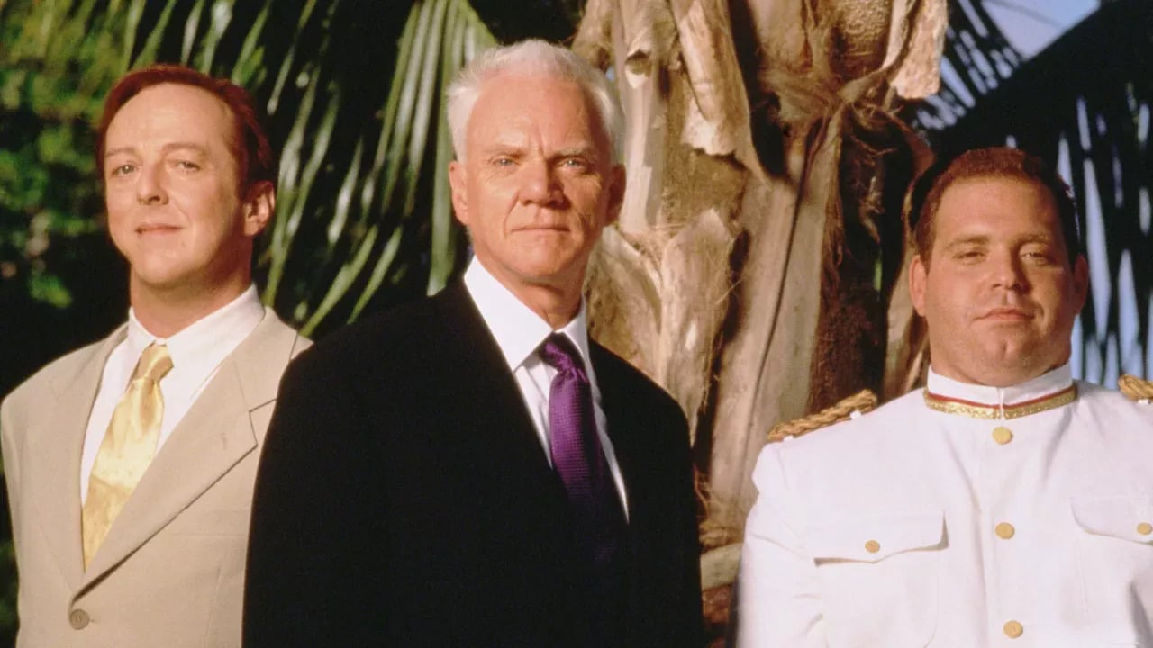 Edward Hibbert, Malcolm McDowell, and Louis Lombardi in the Fantasy Island 1998 revival