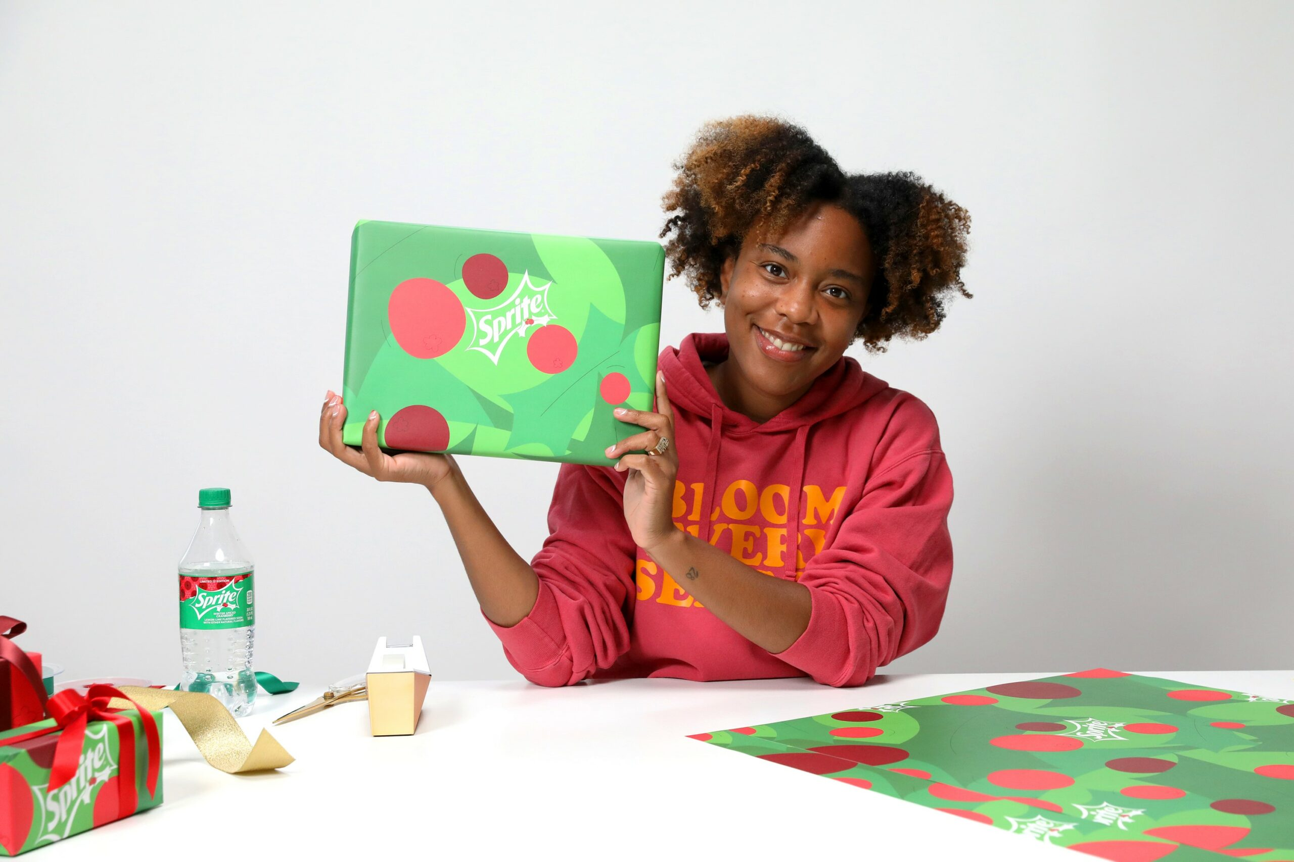 UNWRP founder Ashley Fouyolle with Sprite-themed giftwrap